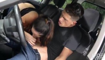 Young blonde is wearing fishnets while fucked in the car